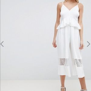 ASOS DESIGN Cami Jumpsuit with Peplum and Lace